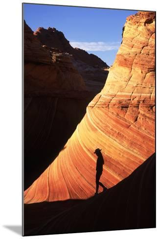 Silhouetted Hiker Against Navajo Sandstone Formations-Ralph Lee Hopkins-Mounted Photographic Print