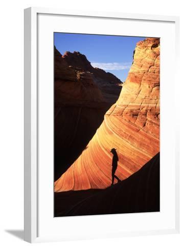 Silhouetted Hiker Against Navajo Sandstone Formations-Ralph Lee Hopkins-Framed Art Print