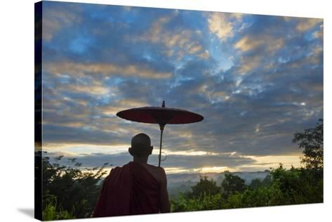 Monk watching ancient temple and pagoda at sunrise, Mrauk-U, Rakhine State, Myanmar-Keren Su-Stretched Canvas Print