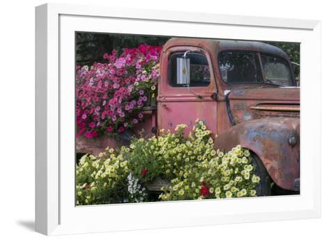 USA, Alaska, Chena Hot Springs. Old truck and flowers.-Jaynes Gallery-Framed Art Print