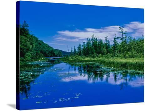 Reflection of clouds on water, Oxbow Lake, New York State Route 28, Speculator, Hamilton County...--Stretched Canvas Print
