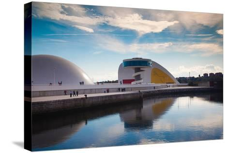 Reflection of a building on water, The Oscar Niemeyer International Cultural Centre, Aviles, Ast...--Stretched Canvas Print