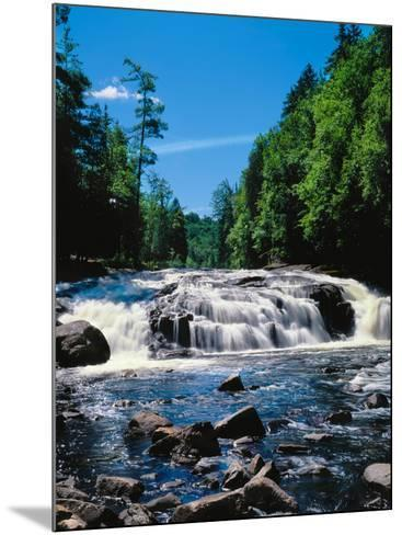 Water flowing from rocks in a forest, Buttermilk Falls, Raquette River, Adirondack Mountains, Ne...--Mounted Photographic Print