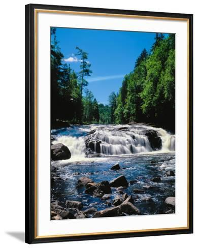 Water flowing from rocks in a forest, Buttermilk Falls, Raquette River, Adirondack Mountains, Ne...--Framed Art Print