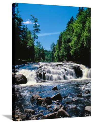 Water flowing from rocks in a forest, Buttermilk Falls, Raquette River, Adirondack Mountains, Ne...--Stretched Canvas Print