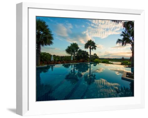 Clouds reflected in the infinity pool at sunrise, Aureum Palace Hotel, Bagan, Mandalay Region, M...--Framed Art Print