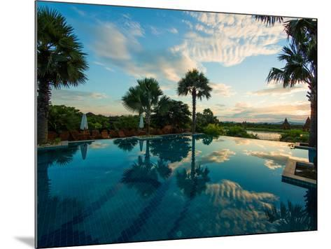 Clouds reflected in the infinity pool at sunrise, Aureum Palace Hotel, Bagan, Mandalay Region, M...--Mounted Photographic Print