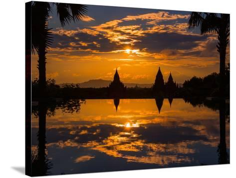 Sunset reflected in the infinity pool at Aureum Palace Hotel, Bagan, Mandalay Region, Myanmar--Stretched Canvas Print