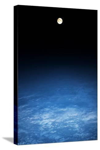 Satellite view of moon over Earth in Russia--Stretched Canvas Print