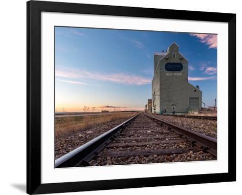 Grain elevator and railroad track, Milk River, Alberta, Canada--Framed Art Print