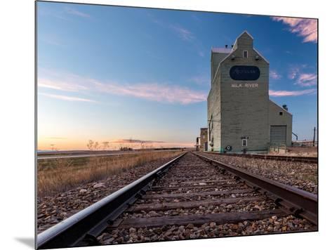 Grain elevator and railroad track, Milk River, Alberta, Canada--Mounted Photographic Print