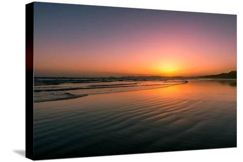 Waves rolling into Long Beach at sunset, Pacific Rim National Park Reserve, Vancouver Island, Br...--Stretched Canvas Print
