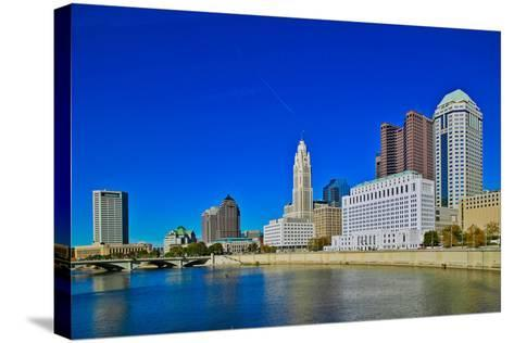 Scioto River and Columbus Ohio skyline in autumn--Stretched Canvas Print