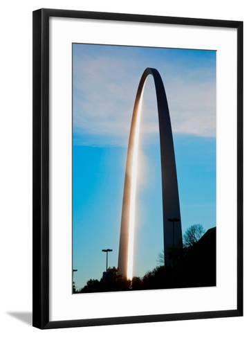 The sunset reflects on the majestic Gateway Arch, the Jefferson National Expansion Memorial, the...--Framed Art Print