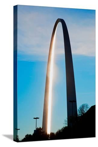 The sunset reflects on the majestic Gateway Arch, the Jefferson National Expansion Memorial, the...--Stretched Canvas Print
