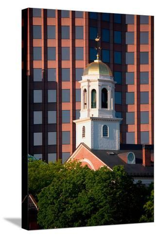 Faneuil Hall Weather Vane Tower, built in 1740-1742, is surrounded by contemporary office buildi...--Stretched Canvas Print