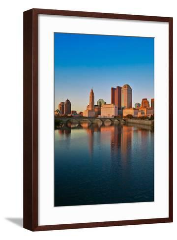 Scioto River and Columbus Ohio skyline in autumn with sunset reflection in water--Framed Art Print
