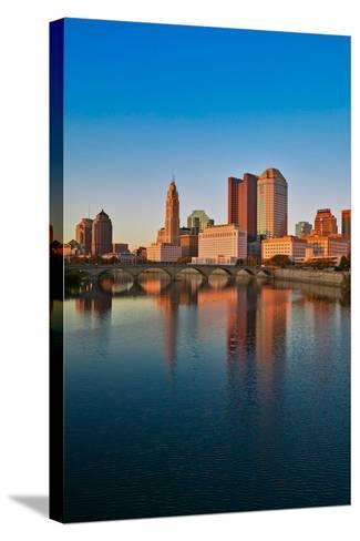 Scioto River and Columbus Ohio skyline in autumn with sunset reflection in water--Stretched Canvas Print