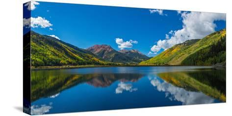 Reflection of clouds and mountain in Crystal Lakes, U.S. Route 550, Colorado, USA--Stretched Canvas Print