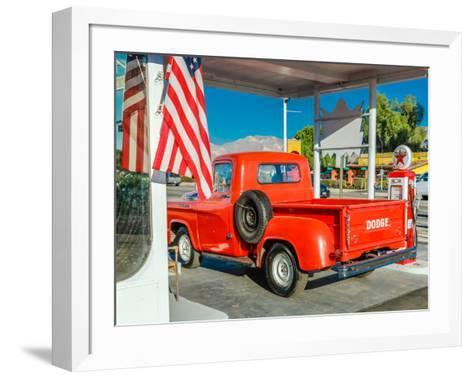 Red Dodge Pickup truck parked in front of vintage gas station in Santa Paula, California--Framed Art Print