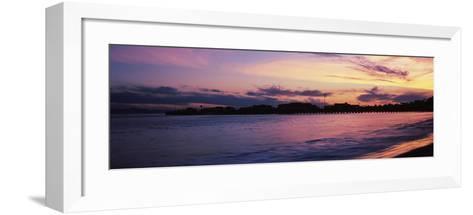 Silhouette of pier in pacific ocean, Santa Barbara, California, USA--Framed Art Print