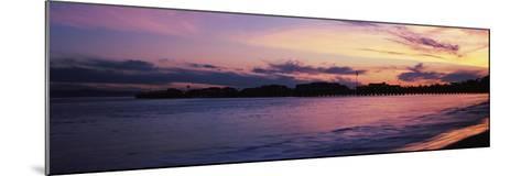 Silhouette of pier in pacific ocean, Santa Barbara, California, USA--Mounted Photographic Print