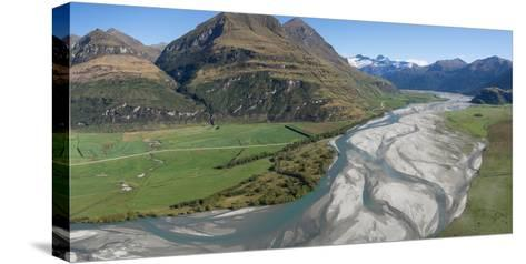 Elevated view of river passing through mountains, Matukituki River, Lake Waneka, Mount Aspiring...--Stretched Canvas Print