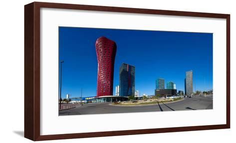 Low angle view of skyscrapers, Fira De Barcelona, Barcelona, Catalonia, Spain--Framed Art Print