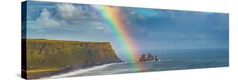 Rainbow over basalt sea stacks, Iceland--Stretched Canvas Print