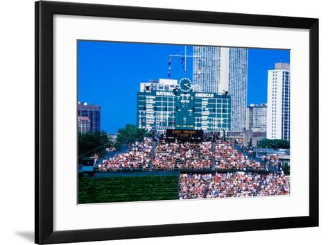 Long view of scoreboard and full bleachers during a professional baseball game, Wrigley Field, I...--Framed Art Print
