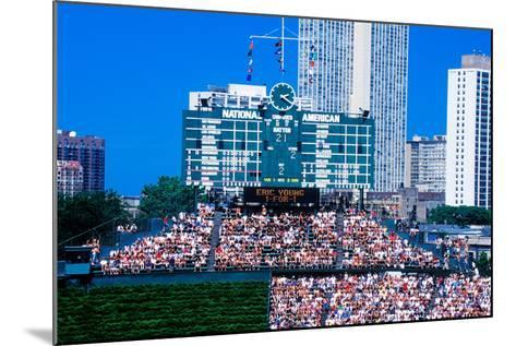 Long view of scoreboard and full bleachers during a professional baseball game, Wrigley Field, I...--Mounted Photographic Print