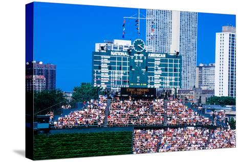 Long view of scoreboard and full bleachers during a professional baseball game, Wrigley Field, I...--Stretched Canvas Print