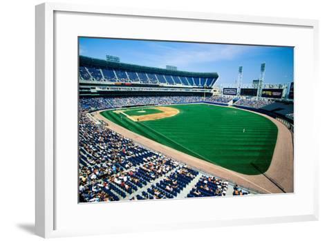 Long view of Baseball diamond and bleachers during professional Baseball Game, Comiskey Park, Il...--Framed Art Print