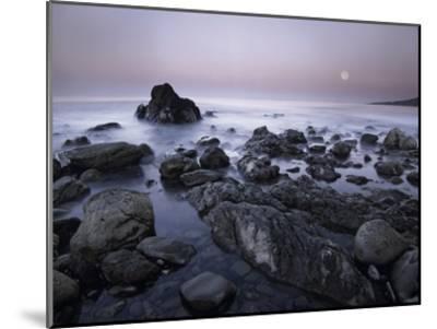 Full moon over boulders at El Pescador State Beach, Malibu, California-Tim Fitzharris-Mounted Art Print
