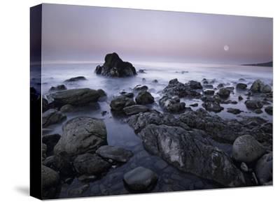 Full moon over boulders at El Pescador State Beach, Malibu, California-Tim Fitzharris-Stretched Canvas Print