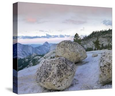 Granite boulders and Half Dome at Olmsted Point, Yosemite National Park, California-Tim Fitzharris-Stretched Canvas Print