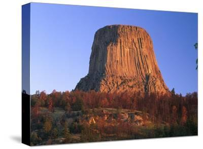 Devil's Tower National Monument showing famous basalt tower, Wyoming-Tim Fitzharris-Stretched Canvas Print