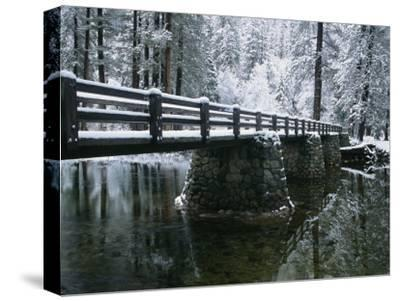 A Snow-Covered Footbridge Spanning the Merced River-Marc Moritsch-Stretched Canvas Print