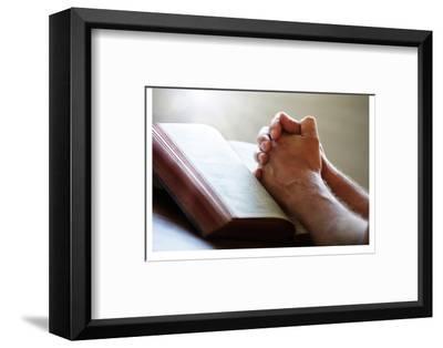 Hands Praying on a Holy Bible--Framed Art Print