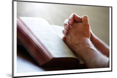 Hands Praying on a Holy Bible--Mounted Art Print