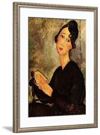 Seated woman with black dress-Amedeo Modigliani-Framed Art Print