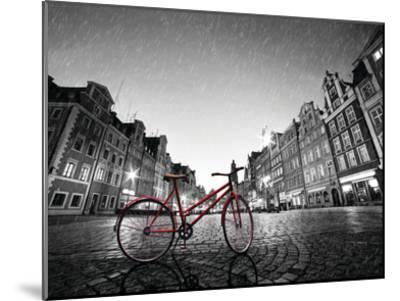 Red BikeOn Cobble Stone Street-Michal Bednarek-Mounted Art Print