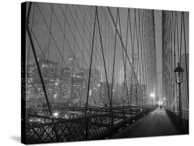 On Brooklyn Bridge by night, NYC-Michel Setboun-Stretched Canvas Print