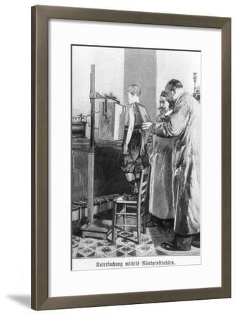 Wilhelm Konrad Roentgen X-Raying a Young Boy, from a Book by Hans Kraemer, circa 1898-99--Framed Giclee Print