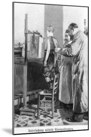 Wilhelm Konrad Roentgen X-Raying a Young Boy, from a Book by Hans Kraemer, circa 1898-99--Mounted Giclee Print