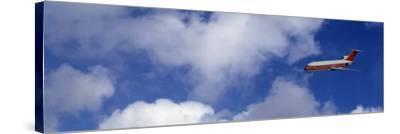 Passenger Jet, Flying, Clouds--Stretched Canvas Print