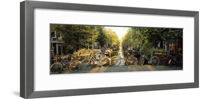 Bicycles on Bridge Over Canal, Amsterdam, Netherlands--Framed Photographic Print