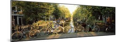 Bicycles on Bridge Over Canal, Amsterdam, Netherlands--Mounted Photographic Print