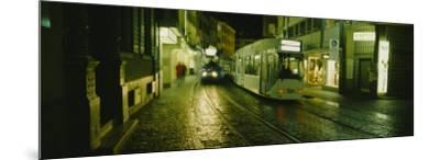 Cable Cars Moving on a Street, Freiburg, Germany--Mounted Photographic Print
