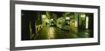 Cable Cars Moving on a Street, Freiburg, Germany--Framed Photographic Print